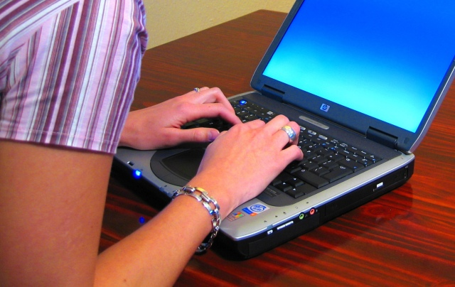 Woman-typing-on-laptop-cropped