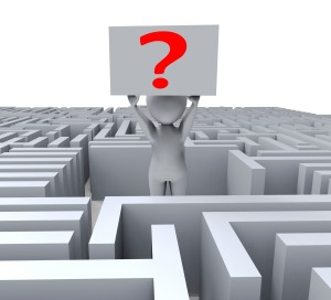 Figure holding question mark in middle of maze