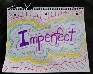 "Handwritten word ""imperfect"" with doodles"